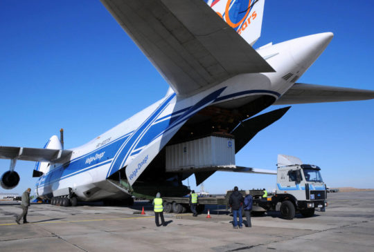 24617969 - baikonur, kazakhstan - november 11, 2013. russian volga-dnepr antonov an-124 long-range heavy transport plane is being unloaded in yubileiny airport.